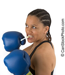 Fighting germs - Woman brushing teeth with boxing gloves