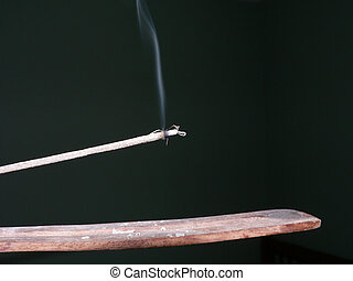 Incense - This is a stick of incense burning