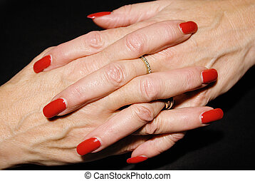 Waiting mature businesswoman with red fingernails.