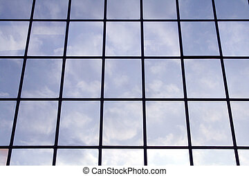 Cloud reflections 2 - Clouds and blue sky reflecting in...