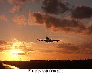 Sunset climb - Boeing 747 leaving at sunset time.