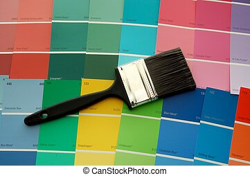 Paint Brush/Color  - A paint brush on paint color cards