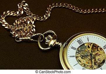 Timepiece - Photo of a Gold Pocket Watch