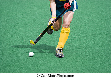 Hockey player running the ball