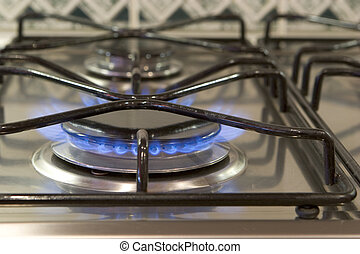 Gas Cooker - blue gas flame on stainless steel cooker burner