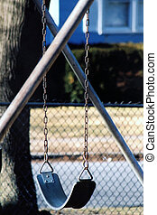 Empty Swing - Vacant swing in a playground