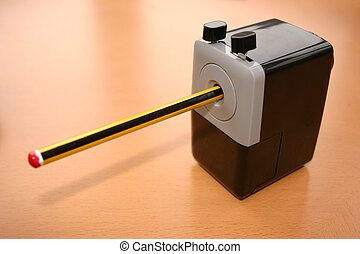 pencil in sharpener - pencil in a sharpener being sharpened