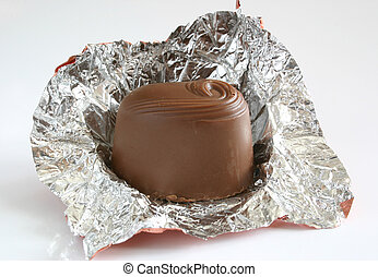 chocolate in wrapper - chocolate sweet in a open foil...