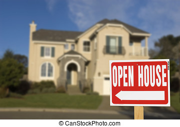 open house - open hourse sign, with out of focus home in the...