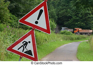 Traffic signs with trucks