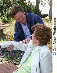 Therapy and Affection - A lovely senior woman receiving...