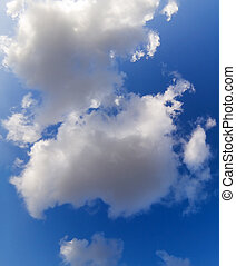 Clouds - White fluffy clouds in a deep blue sky