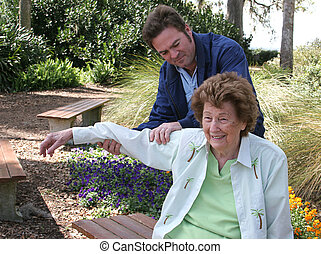 Physical Therapy In The Garden - A senior woman receiving...