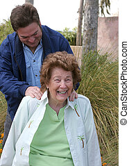 Senior Massage - A lovely senior woman enjoying a back...