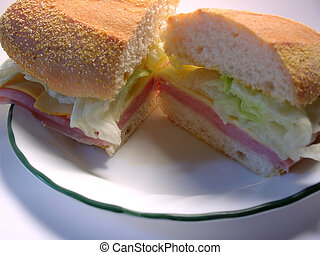 Sandwich - a sandwich made with ham, cheese, and lettuce