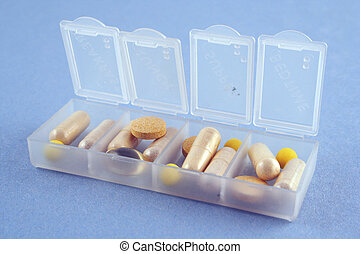 daily drug dosage - a box with daily dose of medications and...