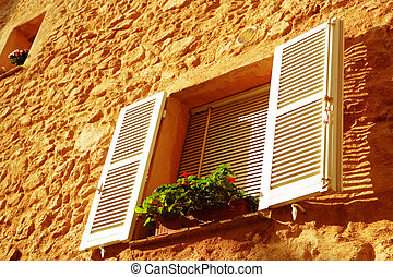french window qith white shutters - window with shutters on...