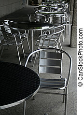Outdoor Cafe - Aluminum table and chairs of an outdoor cafe