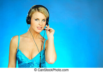Woman with a Headset - Young pretty woman wearing a phone...