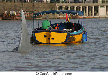 JAWS! - Yellow river taxi being followed by a shark fin