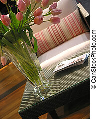 Interior furnuture vase - Vase of pink tulips on a coffee...