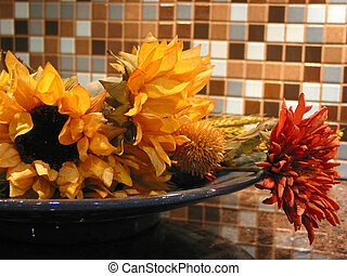 Interior decoration - Artificial flowers in a bowl as...