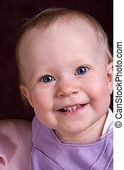 little girl - smiling toddler in purple