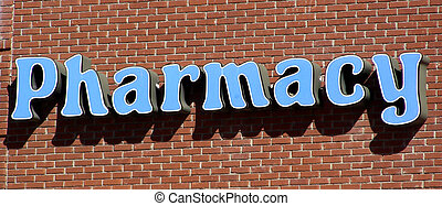 Pharmacy Sign - Pharmacy sign on side of brick building