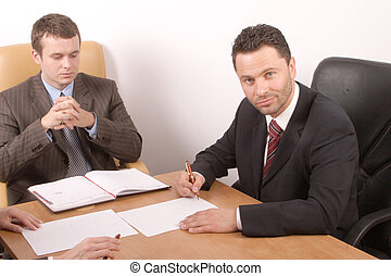 working business men - two business men working on the...