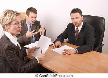 group meeting - Business people preparing contract