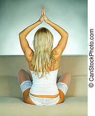 woman exercising - Sexy Young blond woman exercising close...