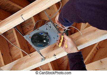 Installing Light Box - electrician installing light box in...