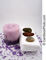 Aromatherapy - A purple candle, some bath crystals, towels...