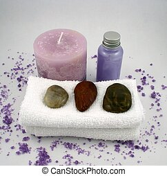 Purple Candle - A purple candle, a bottle of lotion, some...