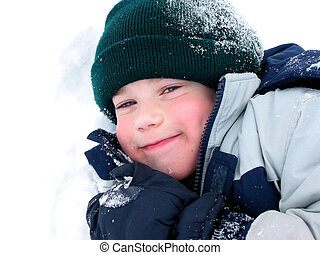 Child fun winter - Young boy playing in fresh powder snow