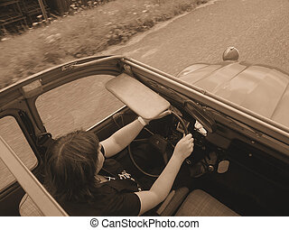 Sunroof Vintage - Open sunroof from the 70ties. Women...