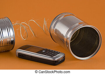 Old and New Communication - Mobile cellphone and 2 cans...