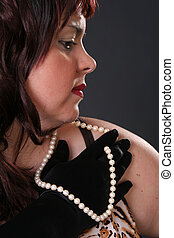 Girl with pearls - Beautiful girl playing with pearls - seen...