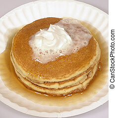 Melting Pancakes - Pancakes with syrup and whipped melting...