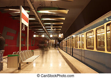 Munich #35 - Moving train in a underground train station....