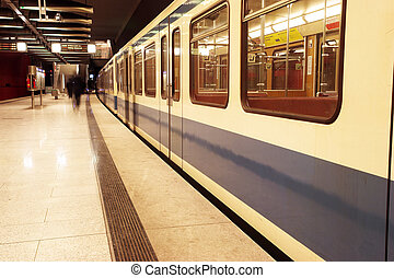 Munich #42 - Moving train in a underground train station....
