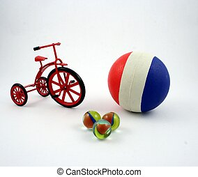 Ball and tricycle - A rubber ball, a cast-iron tricycle and...