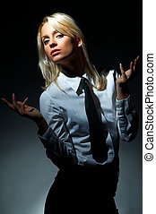 Blond model pose - Blond model, business woman pose on black...