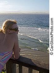 woman watching waves Australia - woman overlooking ocean...