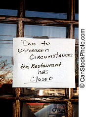 ClosedForBusiness IV - Sign on door of restaurant indicating...