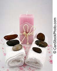 Pink Spa Candle - A pink candle, towels, stones and bath...