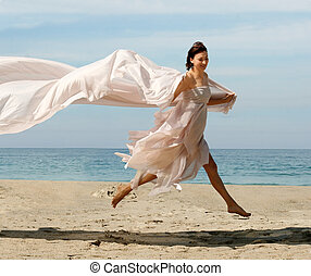 Woman on the beach - Woman jumping on the beach