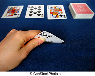 Playing poker - Sneak peek at hand in Texas Hold em