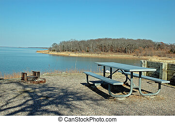 Picnic at the lake - A deserted picnic table overlooks a...