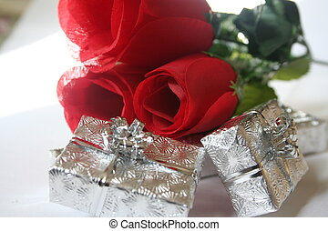 Roses and Gifts - Three roses on silver gifts